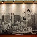 Cuadro de Astro Boy, creado con billetes de tren